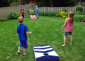 kids-playing-cornhole-game