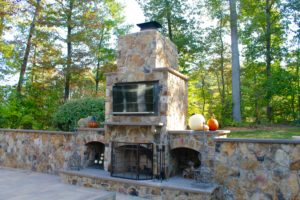 Outdoor TV mounted above outdoor fireplace