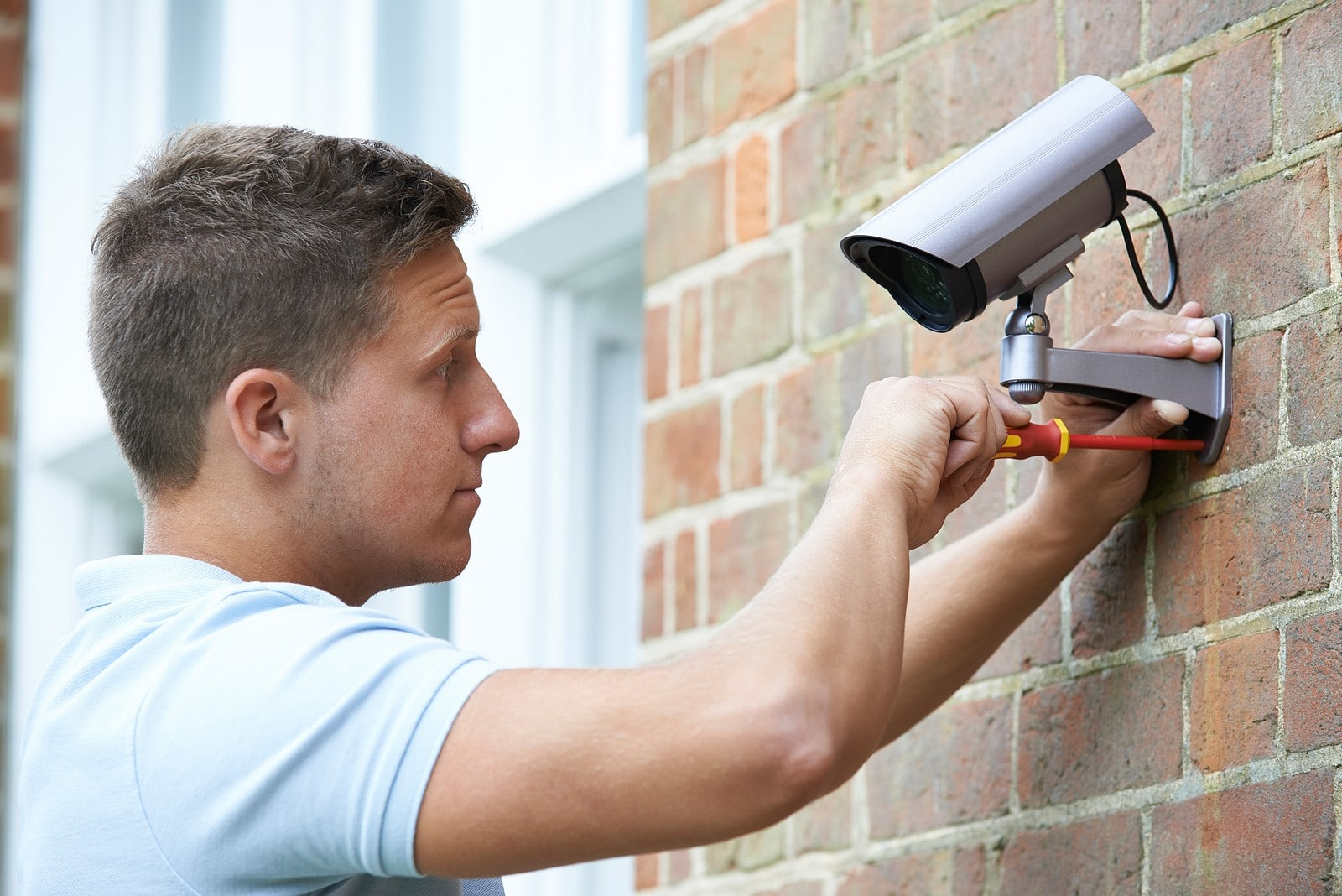Security Consultant Fitting Security Camera